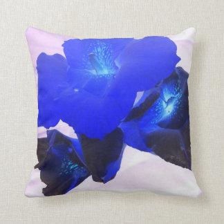 invert blue flowers against pink throw pillow