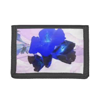 invert blue flowers against pink wallet