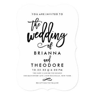 Invitación indicada con letras del boda de la mano