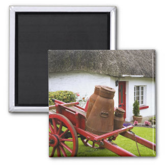 Ireland, Adare. Metal containers on cart and 2 Inch Square Magnet