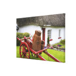 Ireland, Adare. Metal containers on cart and Gallery Wrap Canvas
