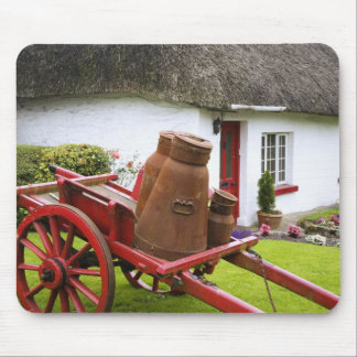 Ireland, Adare. Metal containers on cart and Mouse Pad