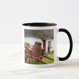 Ireland, Adare. Metal containers on cart and Mug