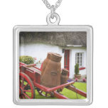 Ireland, Adare. Metal containers on cart and Custom Necklace