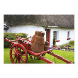 Ireland, Adare. Metal containers on cart and Photo Art