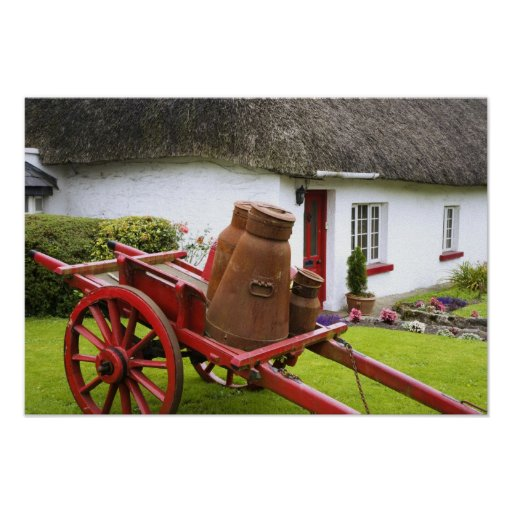 Ireland, Adare. Metal containers on cart and Posters