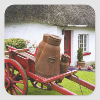 Ireland, Adare. Metal containers on cart and Square Sticker