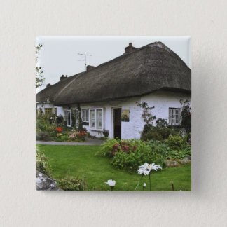 Ireland, Adare. Thatched-roof cottage Button