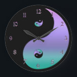 """Iridescent Yin Yang Clock<br><div class=""""desc"""">Iridescent Yin Yang Clock in Black, With Metallic Lavender and Aqua. Bring the symbols of balance, harmony, unity and completeness into your time line with this yin-yang wall clock. Making it easy to keep your eye on the time so you never miss on of your favorite things because you lead...</div>"""