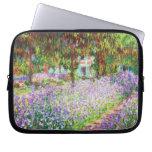 Iris en el jardín Claude Monet de Monet Funda Portátil