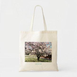Irish sheep under a sakura tree tote bag