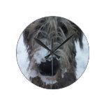 irish wolfhound playing in the snow round clocks