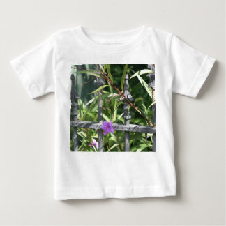 Iron fence, green leaves, purple flower baby T-Shirt