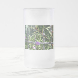 Iron fence, green leaves, purple flower frosted glass beer mug