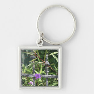 Iron fence, green leaves, purple flower Silver-Colored square keychain