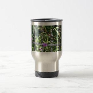Iron fence, green leaves, purple flower travel mug