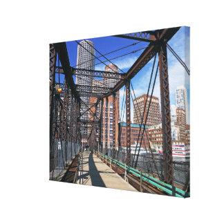 Iron footbridge with Boston Financial district Canvas Print