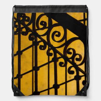 Iron gate pattern in yellow, Cuba Drawstring Backpack