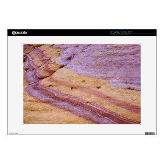 "Iron oxides color a sandstone formation 15"" laptop skins"