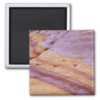 Iron oxides color a sandstone formation 2 inch square magnet