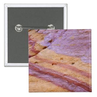 Iron oxides color a sandstone formation button