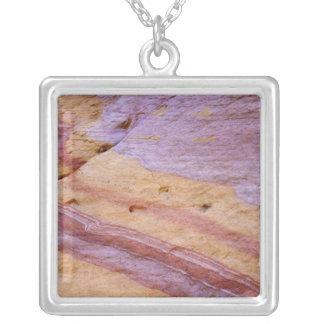 Iron oxides color a sandstone formation square pendant necklace