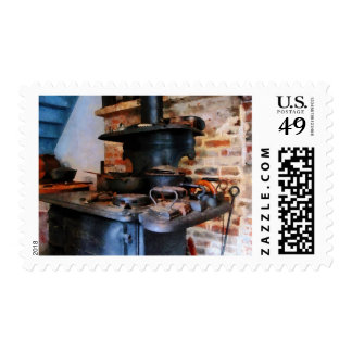 Irons Heating on Stove Postage