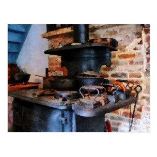 Irons Heating on Stove Postcard