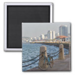 Bicycle at waterfront with Yantai city skyline, Magnet