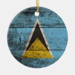 Saint Lucia Flag on Old Wood Grain Ceramic Ornament