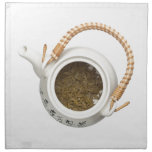 Teapot with chinese tea leaves napkin