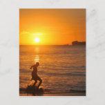 Football at sunset postcard