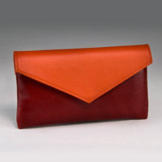 Rojo suave del lápiz labial del grano y naranja