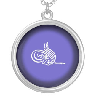 Islamic necklace with Bismillah on blue background