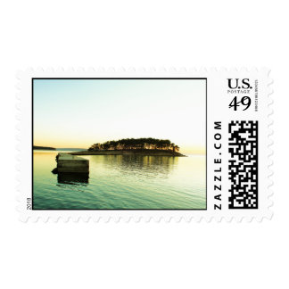 Island on a lake covered with trees postage stamps