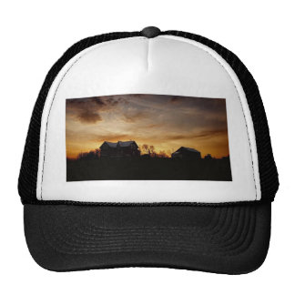 Island sunset over the farm trucker hat