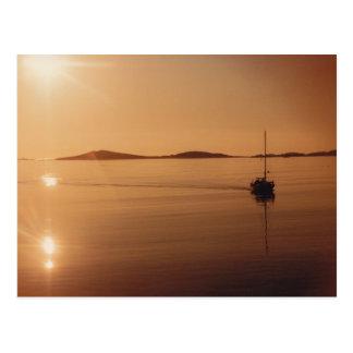 Islas de la postal de la puesta del sol de Scilly