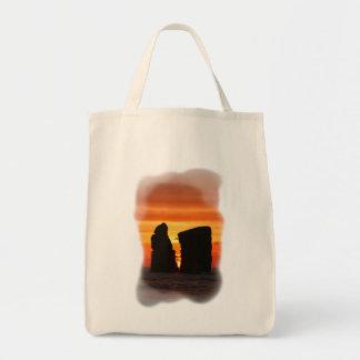 Islotes en la puesta del sol bolsa