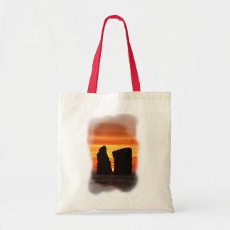 Islotes en la puesta del sol bolsas