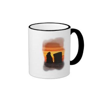 Islotes en la puesta del sol tazas