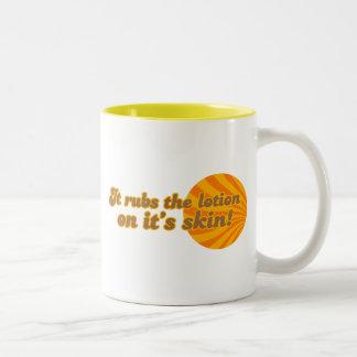 It puts the lotion on its skin Two-Tone coffee mug