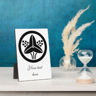 """It stands in the house crest """"circle, the water plaque"""