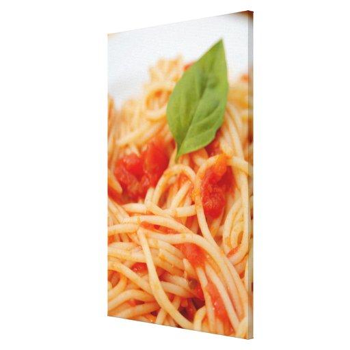Italia, Orta, lago Orta, espagueti con el tomate Impresión De Lienzo
