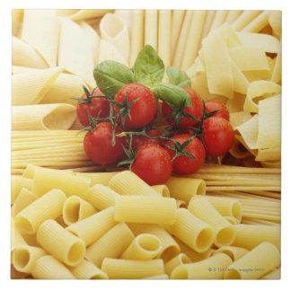 Italian cuisine. Pasta and tomatoes. Tiles