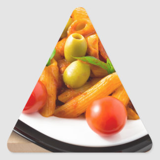 Italian pasta penne in tomato sauce with olives triangle sticker