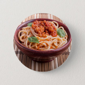 Italian spaghetti with tomato relish and basil button