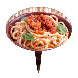 Italian spaghetti with tomato relish and basil cake topper