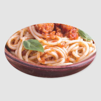 Italian spaghetti with tomato relish and basil oval sticker