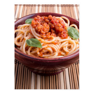 Italian spaghetti with tomato relish and basil postcard