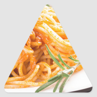 Italian spaghetti with vegetable sauce closeup triangle sticker
